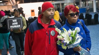 Michael Brown's mother, Lesley McSpadden, is greeted by her husband, Louis Head, after arriving at St. Louis International Airport Nov. 14, 2014, from Geneva, where she addressed the United Nations Committee Against Torture.Scott Olson/Getty Images