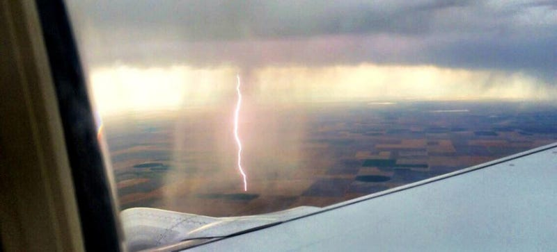 Illustration for article titled Airplane passenger captures cool shot of lightning striking the ground
