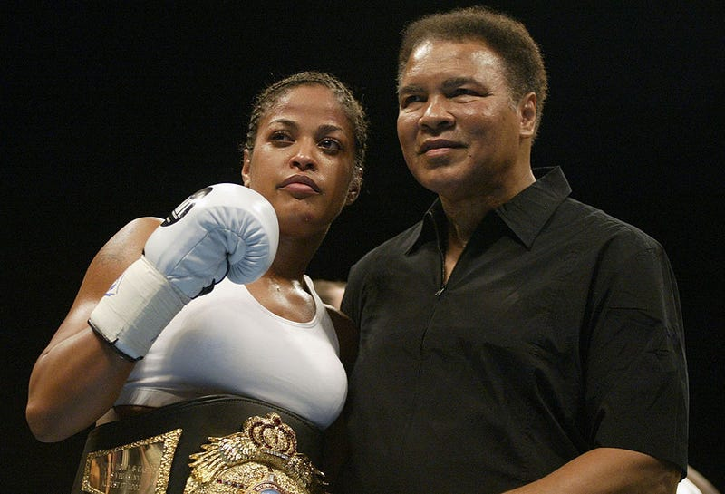 Boxer Laila Ali poses with her father, former heavyweight champion Muhammad Ali, after she defeated Suzy Taylor in two rounds at the Aladdin Casino in Las Vegas on Aug. 17, 2002.Scott Halleran/Getty Images