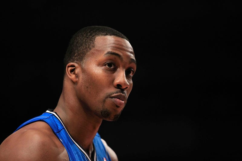 Illustration for article titled Dwight Howard Claims The Magic Blackmailed Him, Is A Crazy Person