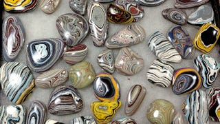 Illustration for article titled These Gorgeous Stones Are Actually Polished Chunks Of Car Paint