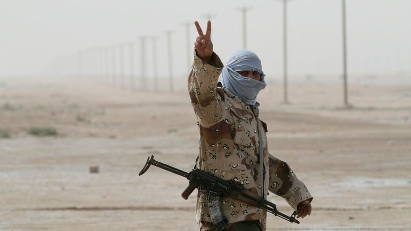 "A Libyan rebel soldier flashes the ""V for victory"" sign as he prepares for battle in the eastern city of Ajdabiya (AFP/Getty Images)"