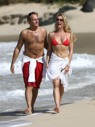 Illustration for article titled Michael Bolton And Nicollette Sheridan Are Yukking It Up In St. Barths