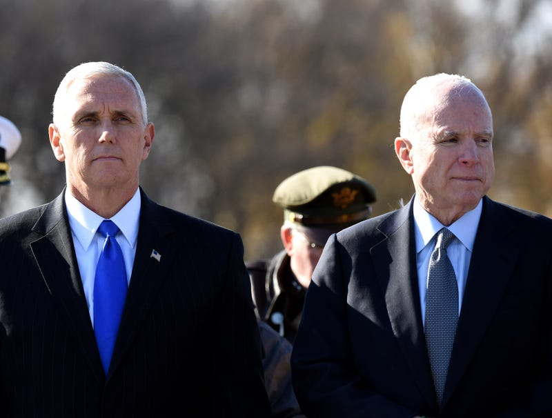 Illustration for article titled Excited Mike Pence Assures John McCain He Has His 'Last Rites' Kit Ready To Go Just In Case