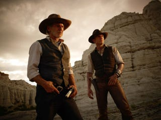Illustration for article titled Take a closer look at Cowboys and Aliens' all-out extraterrestrial war