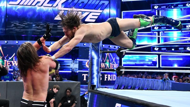 Daniel Bryan dives onto A.J. Styles in their match at Tuesday's SmackDown taping in Atlanta, which was moved from this Friday's Crown Jewel event in Saudi Arabia.