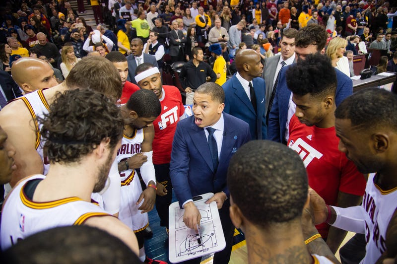 Coach Tyronn Lue (center) of the Cleveland Cavaliers talks to the team prior to a game against the Chicago Bulls on Jan. 23, 2016, in Cleveland. Jason Miller/Getty Images