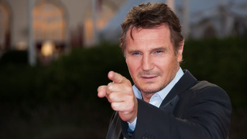 Liam Neeson, pointing like he means it.