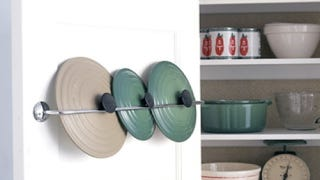 Illustration for article titled Repurpose a Towel Rack into a Pot Lid Rack