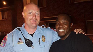 Raleigh, N.C., Police Officer J.D. Boyd shared this photo and the story of what happened the night he met Cory Sanders (right) in October 2014. Facebook