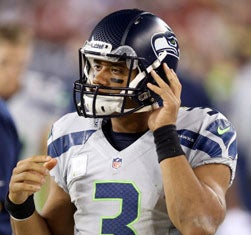 Russell Wilson wearing Riddell helmetRob Carr/Getty Images