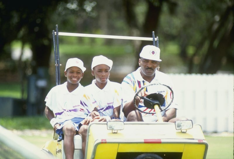 Serena Williams and her sister Venus Williams ride with their father Richard Williams at a tennis camp in Florida.