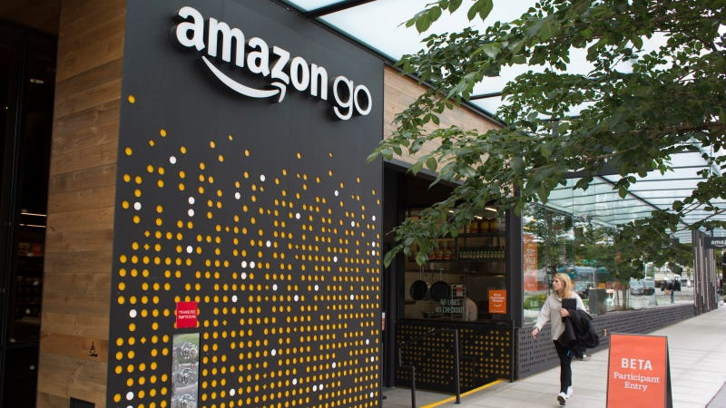 A woman walks past the Amazon Go grocery store at the Amazon corporate headquarters on June 16 in Seattle.