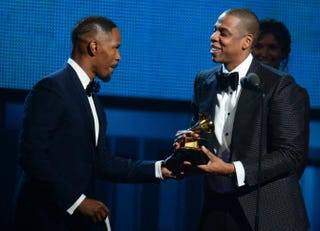 Jamie Foxx presents the Best Rap/Sung Collaboration Award to Jay Z during the 56th Grammy Awards at the Staples Center in Los Angeles, Jan. 26, 2014.FREDERIC J. BROWN/AFP/Getty Images