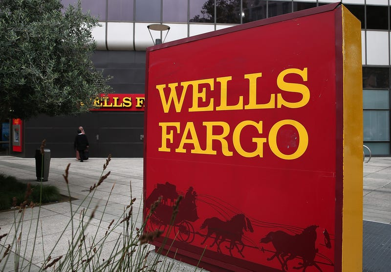 A sign is posted in front of a Wells Fargo bank Oct. 11, 2013, in Oakland, Calif. Justin Sullivan/Getty Images