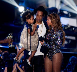 Jay Z and Beyoncé with their daughter, Blue Ivy Carter, onstage during the 2014 MTV Video Music Awards at the Forum on Aug. 24, 2014, in Inglewood, Calif. Mark Davis/Getty Images