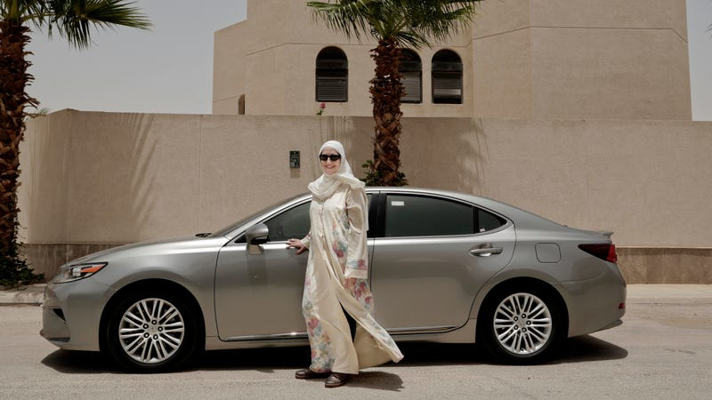 In this Sunday, June 24, 2018 photo, Ammal Farahat, who has signed up to be a driver for Careem, a regional ride-hailing service that is a competitor to Uber, poses for a photograph next to her car on a street in Riyadh, Saudi Arabia.