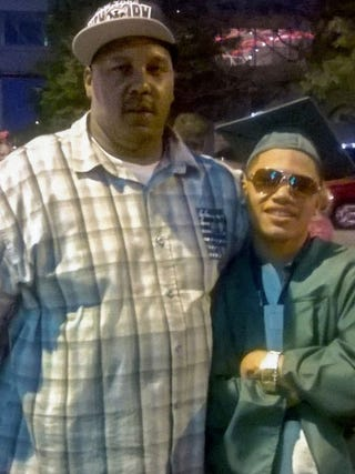 Terrill Thomas with his son at his son's high school graduation in 2014Family photo via the Milwaukee Journal Sentinel