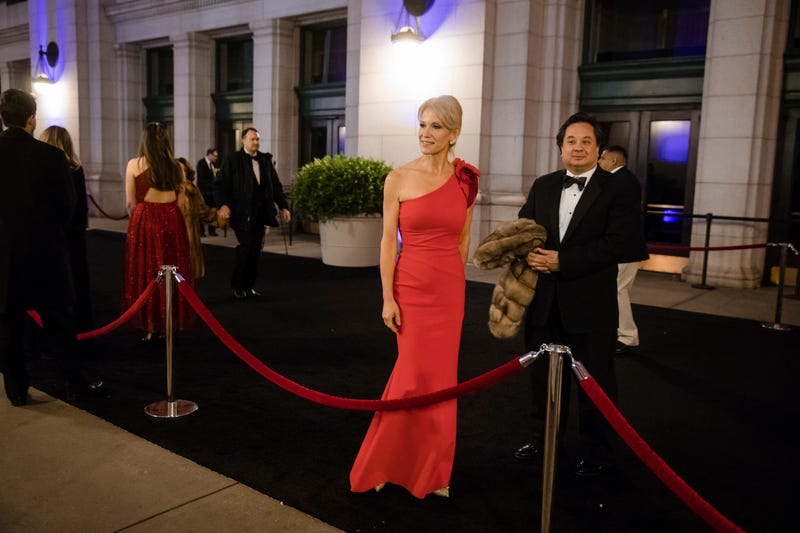 Kellyanne Conway, center, accompanied by her husband, George, speaks with members of the media as they arrive for a dinner at Union Station in Washington, the day before Trump's inauguration. (AP Photo/)