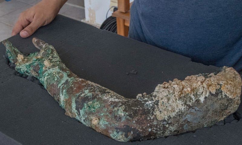 A sediment-encrusted bronze arm recovered from the Antikythera wreck. (Brett Seymour/EUA/ARGO 2017)