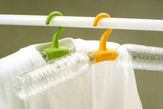Illustration for article titled Rethink Hangers Drape Clothing From Water Bottles