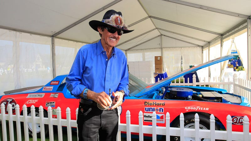 Richard Petty with one of his race cars at the Chiquita Classic golf tournament.