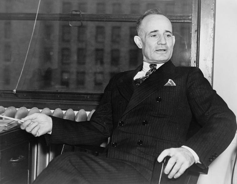 Napoleon Hill sitting in an office in 1937 (Library of Congress)