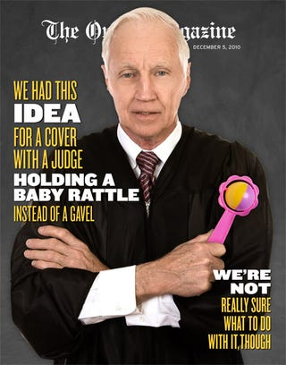 Illustration for article titled We Had This Idea For A Cover With A Judge Holding A Baby Rattle Instead Of A Gavel, We're Not Really Sure What To Do With It, Though