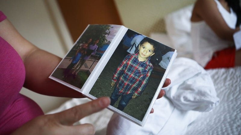 An immigrant who identified herself only as Vioney, recently released after spending six months in an ICE detention facility, displays a photo of her son in her hotel room before flying to be reunited with family members on September 2, 2018 in Los Angeles, California.