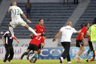 Illustration for article titled Libya-Algeria Soccer Brawl Featured A Perfect Flying Kick To The Head