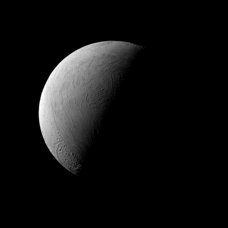 Illustration for article titled A Half-Lit Enceladus Looks Stunning In This Latest Image From Cassini