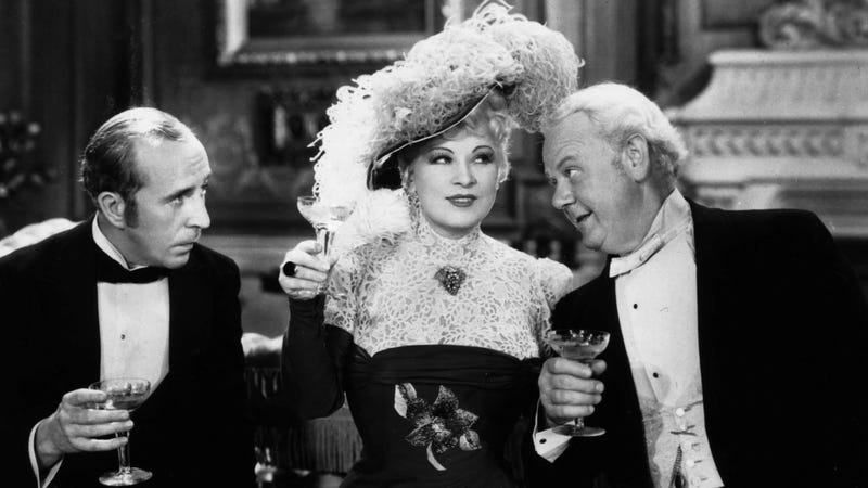 "Mae West is shown in character with her costars Charles Butterworth, left, and Charles Winninger as they sip champagne in a movie scene from ""Every Day's A Holiday"" in Hollywood, Ca., 1937. Photo via AP Images."