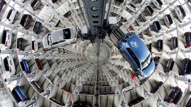 VW cars in a delivery tower. Photo: AP