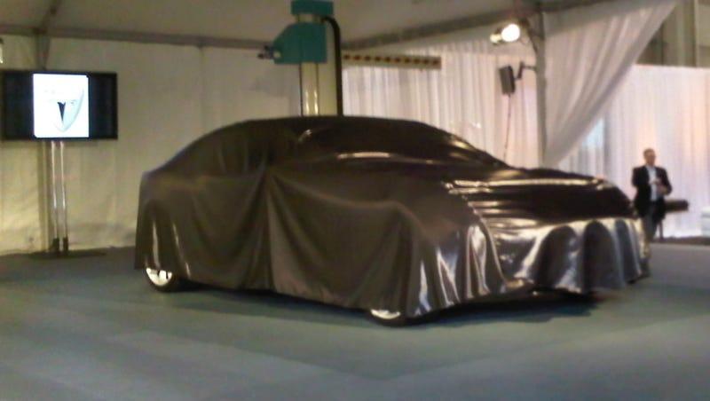 Illustration for article titled Live From SpaceX, It's The Tesla Model S Sedan Concept... Under A Sheet
