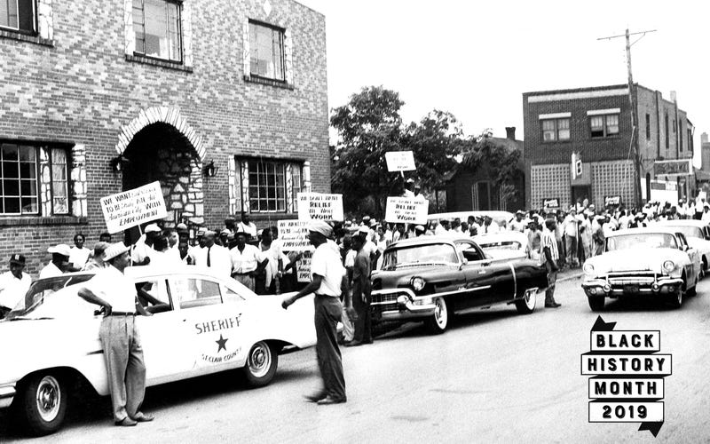 Black demonstrators protest hiring practices at a $13 million federal housing project in East St. Louis, Illinois, Aug. 8, 1960.