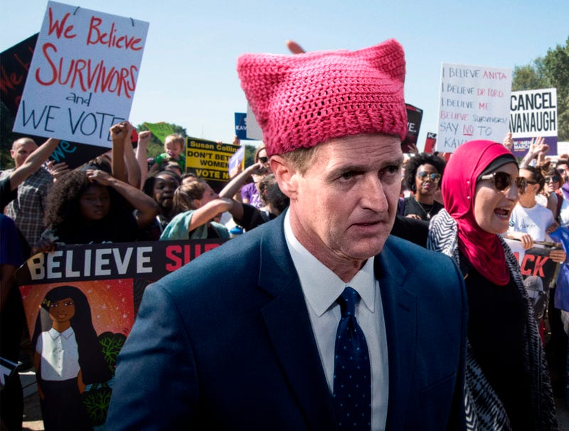Illustration for article titled Pussy-Hat-Wearing Jeff Flake Spotted Protesting Outside Senate Ahead Of Voting Yes For Kavanaugh