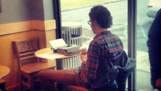 Illustration for article titled Look at This Idiot Using His Typewriter in a Starbucks
