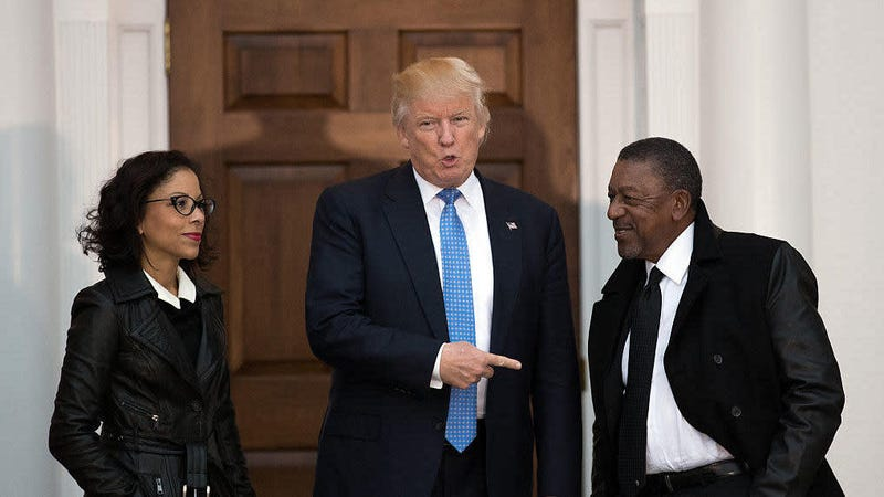 In this November 2016 photo, Donald Trump greets Robert Johnson (right), the founder of BET, and NFL executive Traci Otey Blunt as they arrive for a meeting with Trump at his Bedminster Township, N.J., golf club following Trump's presidential election win.