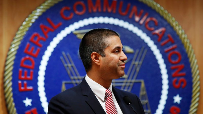 After a meeting voting to end net neutrality, Federal Communications Commission (FCC) Chairman Ajit Pai smiles while listening to a question from a reporter in Washington.