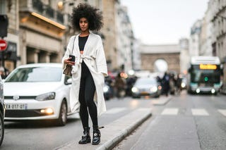 Black model with a Gucci bag during Paris Fashion Week on Jan. 25, 2017 (Edward Berthelot/Getty Images)
