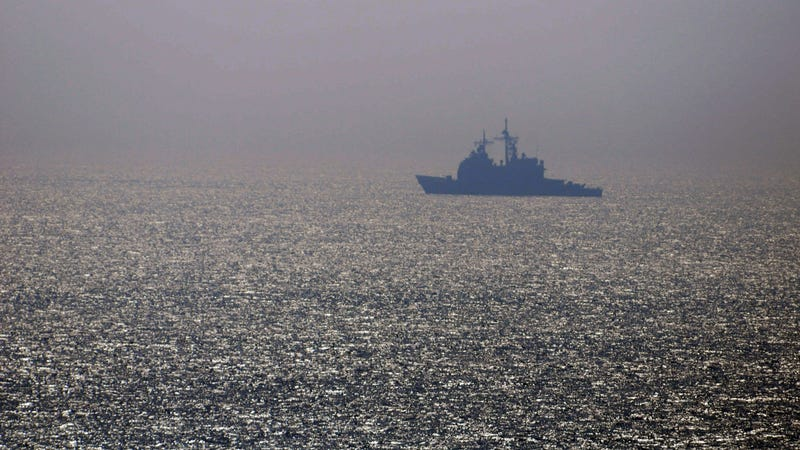 A US warship cruises through the Gulf of Oman.