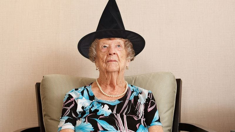 A Grandma wearing a witch hat.