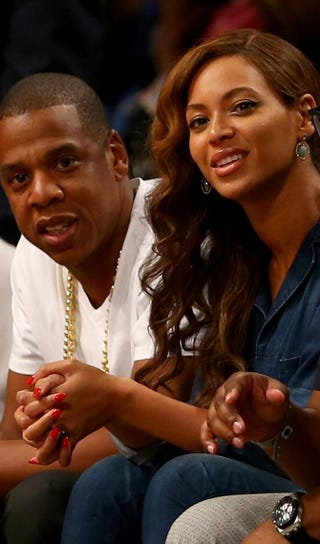Jay Z and Beyoncé attend Game 4 of the Eastern Conference semifinals during the 2014 NBA Playoffs on May 12, 2014, at the Barclays Center in Brooklyn, N.Y.Elsa/Getty Images