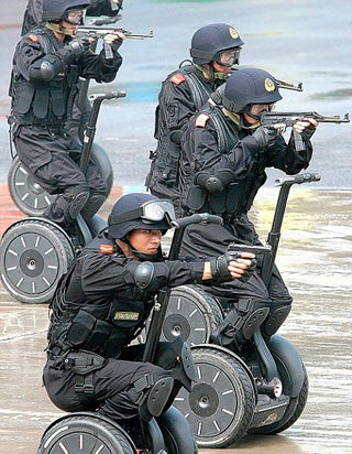 Illustration for article titled Olympic Criminals Are No Match For The Chinese Scooter Police