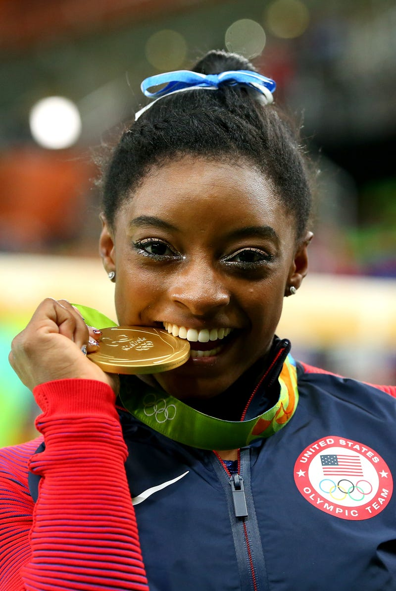 Gold medalist Simone Biles of the United States poses for photographs after the medal ceremony for the Women's Individual All Around on day 6 of the 2016 Rio Olympics on Aug. 11, 2016, in Rio de Janeiro. Alex Livesey/Getty Images