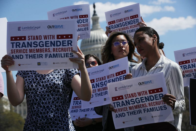 Activists rally at the U.S. Capitol April 10, 2019, against the transgender military service ban.