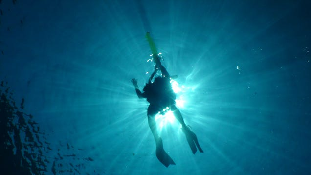 A scientist rises to the surface after completing decompression.