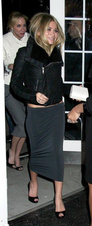 Illustration for article titled Ashley Olsen's Tucked-In Hair, Tight Skirt, Big Smile