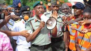 Nigerian Defense spokesman Maj. Gen. Chris Olukolade (center) speaks to civil society groups protesting the abduction of the Chibok schoolgirls during a May 6, 2014, rally in Abuja pressing for the girls' release.PIUS UTOMI EKPEI/AFP/Getty Images