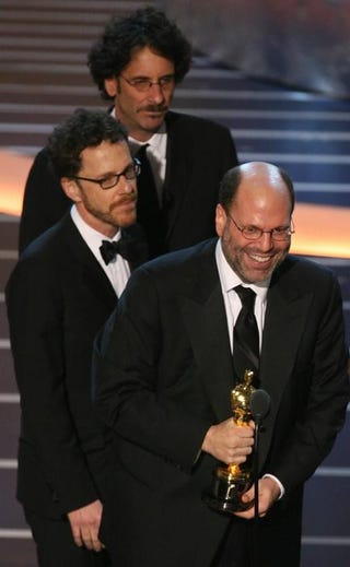 Producer Scott Rudin accepts the Oscar for best feature film for No Country for Old Men as winners for best director for the same film, Joel and Ethan Coen, look on during the 80th annual Academy Awards in Hollywood, Calif., on Feb. 24, 2008.GABRIEL BOUYS/AFP/Getty Images